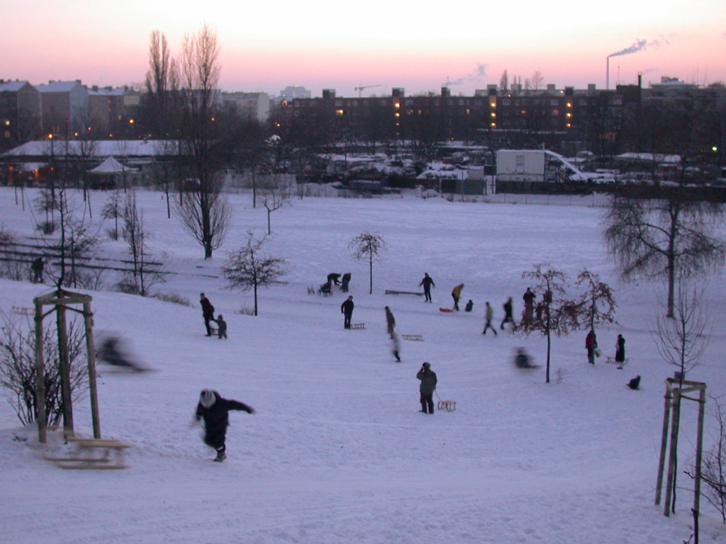 Berlin winter: people riding their sledge sle Mauerpark Prenzlauer Berg