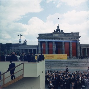 Berlin Quotes: Ich bin ein Berliner by John F. Kennedy - Photo: Kennedy at the Berlin Wall / Wall Brandenburg Gate, 1963